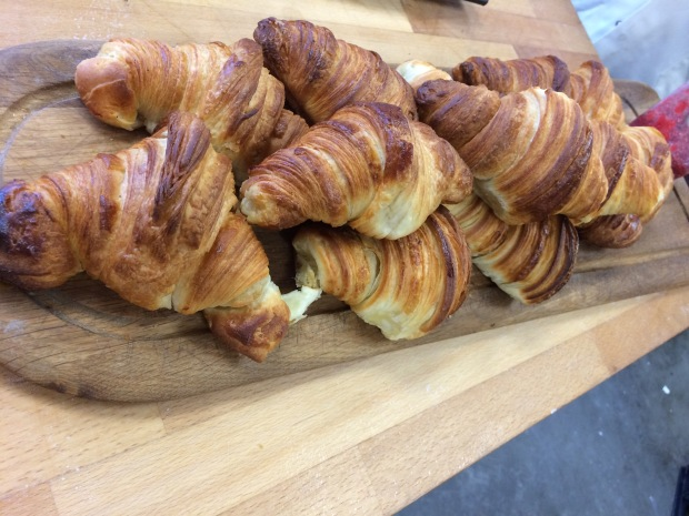 fresh batch of croissants with jam bread ahead